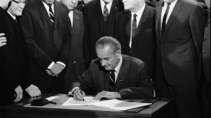 President Johnson signs the Civil Rights Act into Law